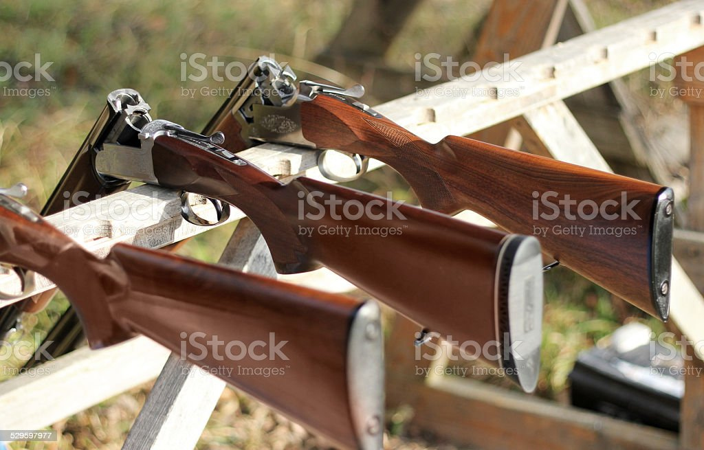 Skeet shooting, closeup of a shotgun stock photo