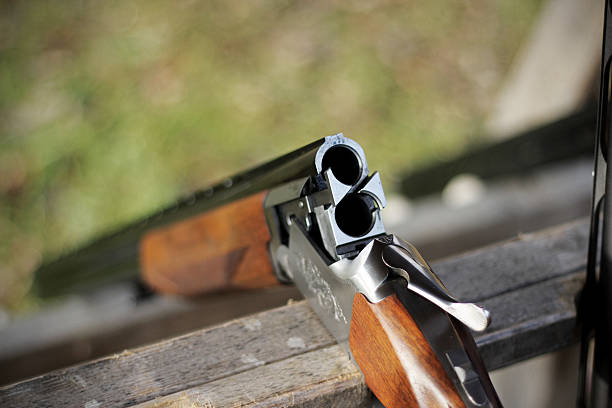 Skeet shooting, closeup of a shotgun stock photo