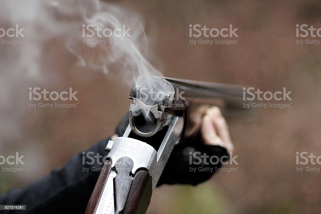 Skeet shooting with a traditional shotgun stock photo