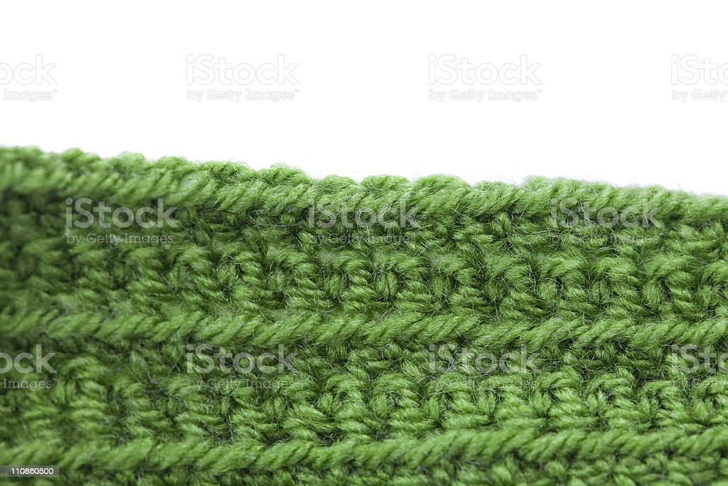Skein of wool  and knitted piece isolated on white stock photo