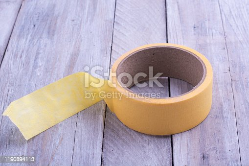 istock A skein of yellow tape on an old wooden table. 1190894113