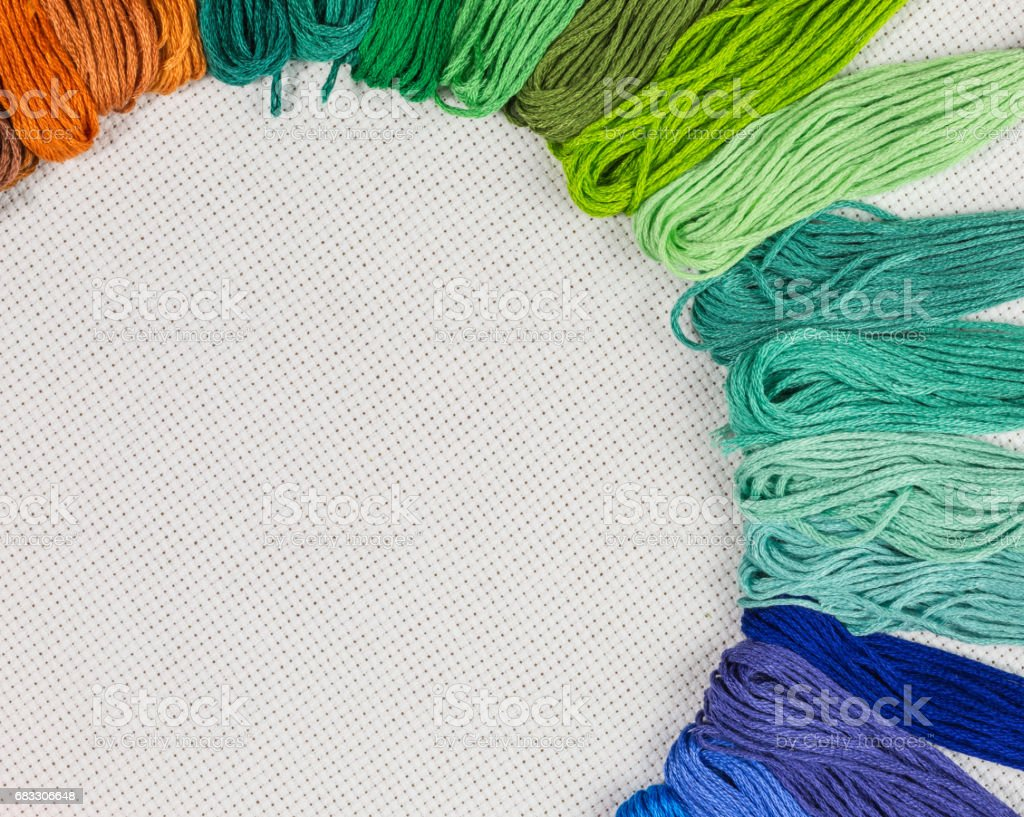 skeins of embroidery thread on white canvas foto stock royalty-free