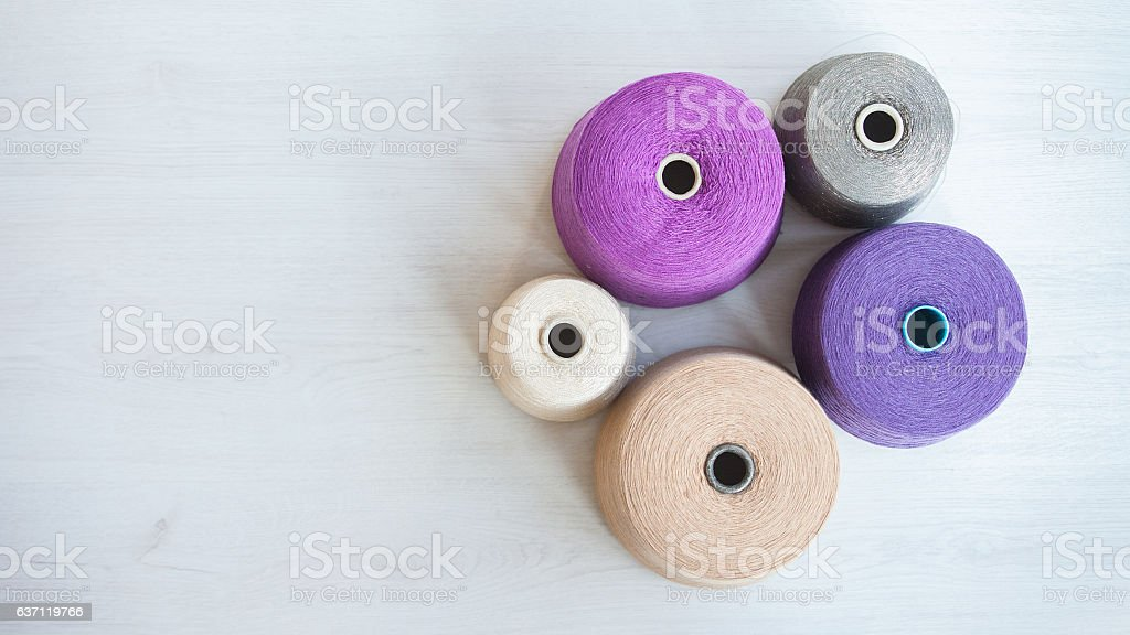 skeins of wool on background gray wood stock photo