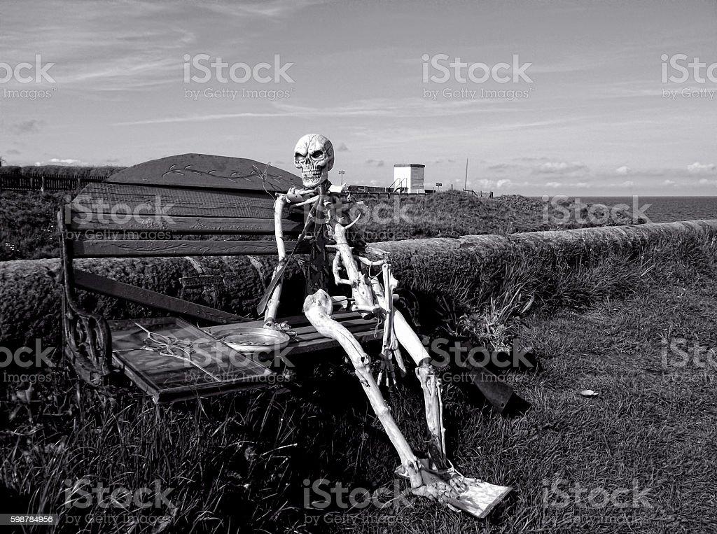 Skeleton at the beach stock photo