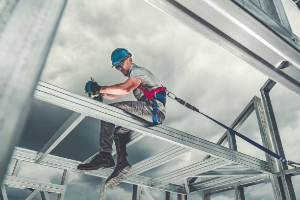 Skeleton Frame Worker Safety Construction Steel Skeleton Frame Worker Safety Harness Theme. Residential and Commercial Building. safety harness stock pictures, royalty-free photos & images