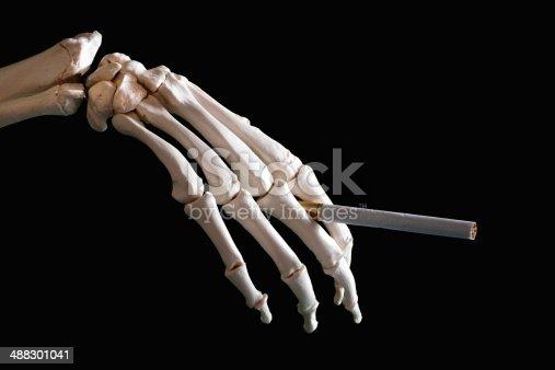 Skeleton hand holding cigarette