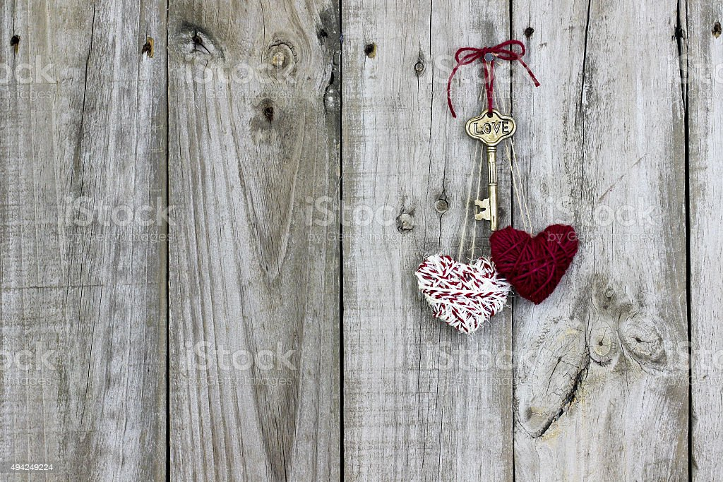Skeleton key and hearts hanging on door stock photo