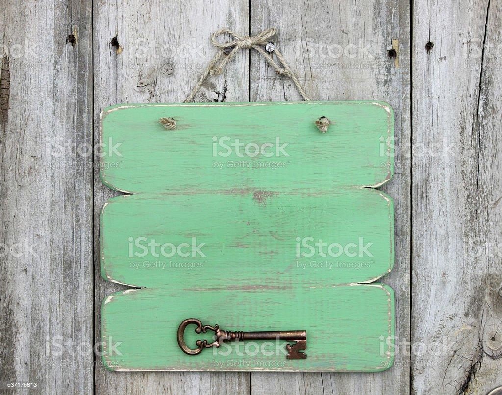 Skeleton key on blank green sign stock photo