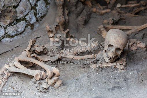 Herculaneum, Italy. 04-24-2019. Skeleton of petrified body at Herculaneum ancient roman city in Italy