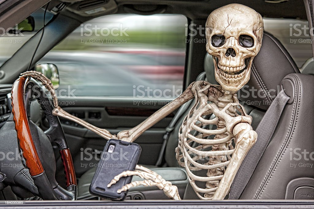 Skeleton Texting and Driving stock photo