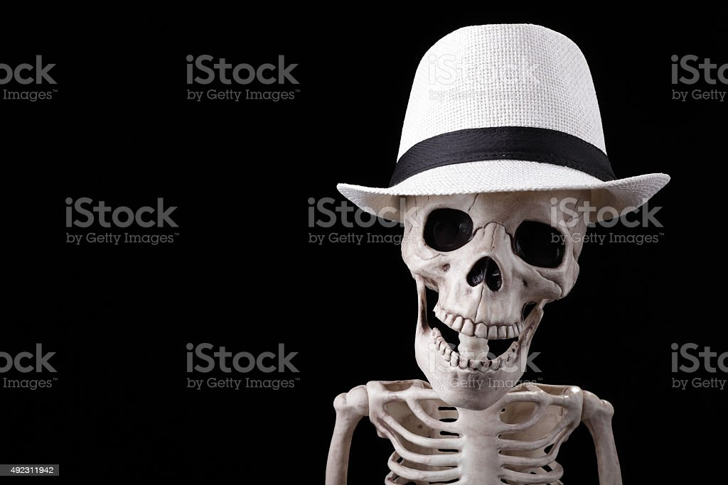 Skeleton wearing white hat stock photo