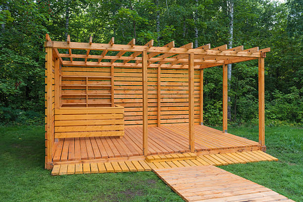 skeleton wooden gazebo in the park - terrassen deck design stock-fotos und bilder