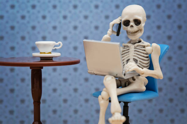 skeleton working day - human skeleton stock photos and pictures