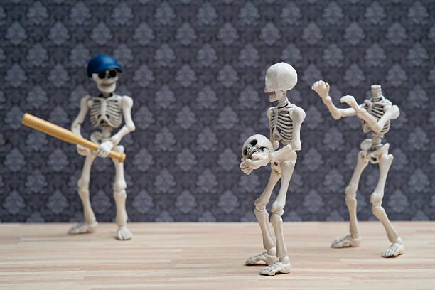 skeletons baseball game - zum totlachen stock-fotos und bilder
