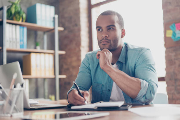 skeptic, unsure, uncertain, doubts concept. young african student is making decision sitting at the office in casual smart - definite stock pictures, royalty-free photos & images