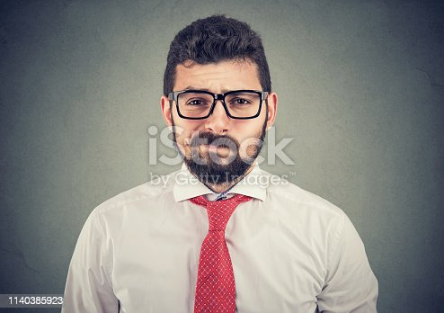 istock Skeptical doubtful business man looking at camera 1140385923