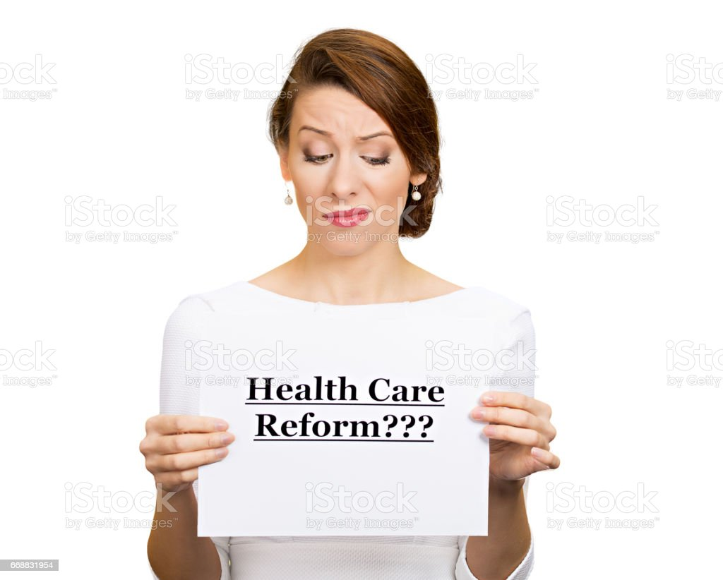 skeptical female, citizen, professional, doctor, holding sign health care reform stock photo