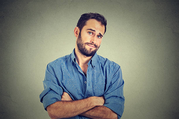 skeptical man looking suspicious, disgust on his face - disdainful stock pictures, royalty-free photos & images