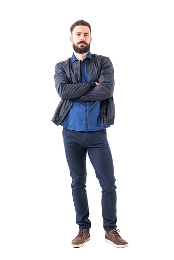 931173966 istock photo Skeptical suspicious uncertain bearded man with folded hands looking at camera. 942518596