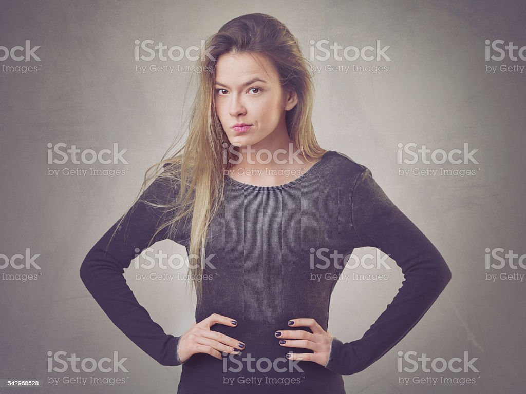 Skeptical woman with massy hair stock photo