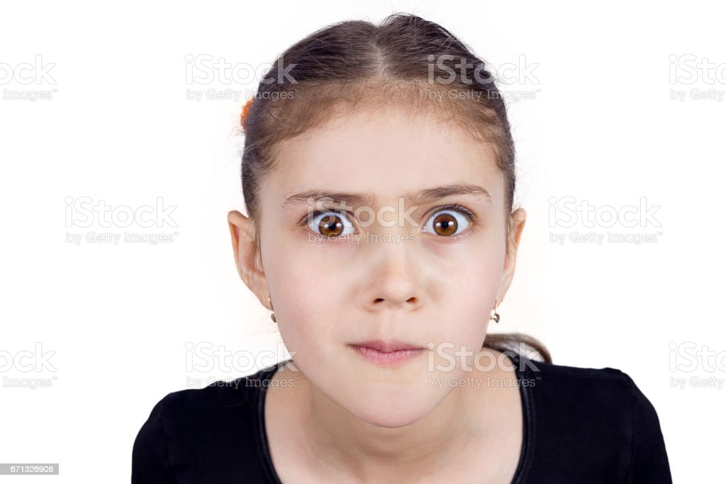 skeptical young girl looking suspicious, disapproval, surprise on face stock photo