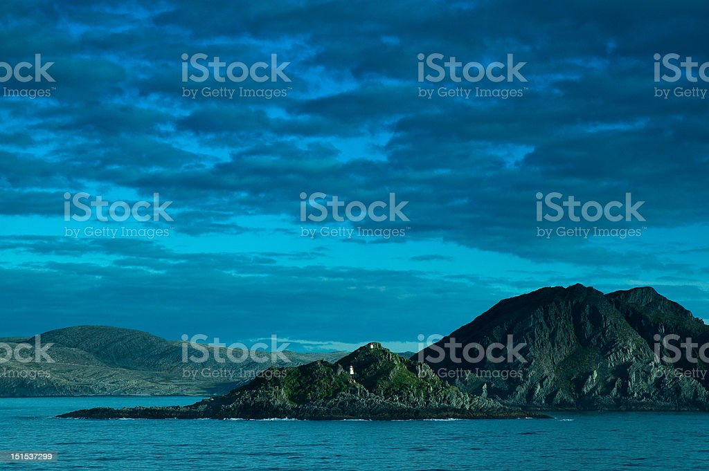 Skerry, shore and clouds stock photo