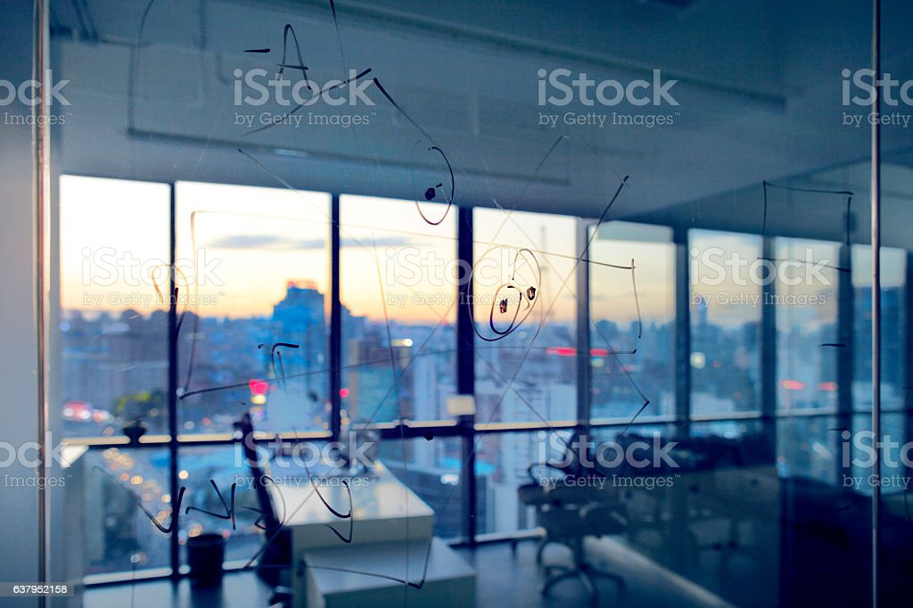 Sketch diagrams on glass wall in design planning office stock photo