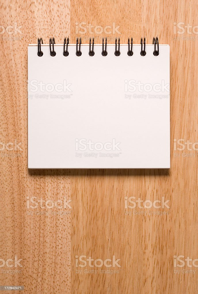 Sketchbook on wood background royalty-free stock photo