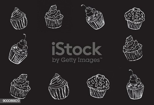 istock Sketches of cake, cup cake hand-drawn with chalks on blackboard. 900086620