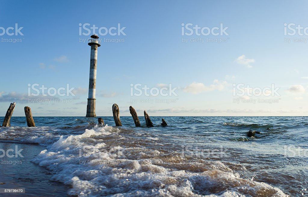 Skew lighthouse, stormy night, beach. Kiipsaar, Harilaid, Saaremaa, Estonia, Europe. stock photo