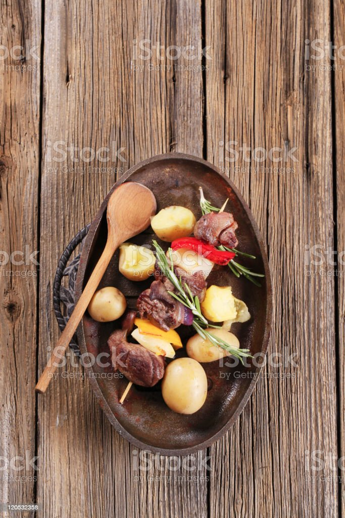 Skewer with new potatoes royalty-free stock photo