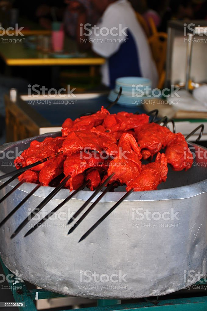 Skewers of raw tandoor chicken stock photo