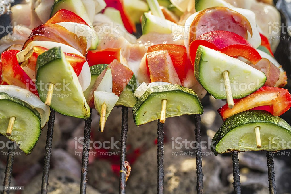 Skewers with vegetables on the grill royalty-free stock photo