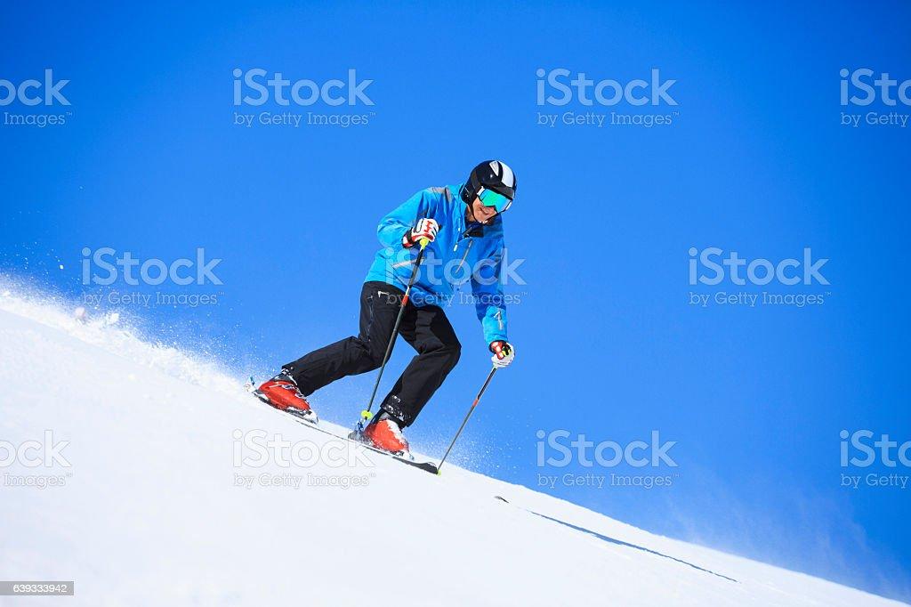 Ski Active senior men snow skier skiing Sunny ski resorts stock photo