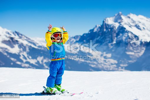 istock Ski and snow fun for child in winter mountains 628812948
