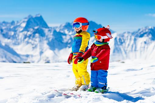 istock Ski and snow winter fun for kids. Children skiing. 869520600