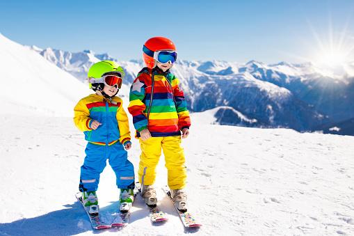 istock Ski and snow winter fun for kids. Children skiing. 895584198