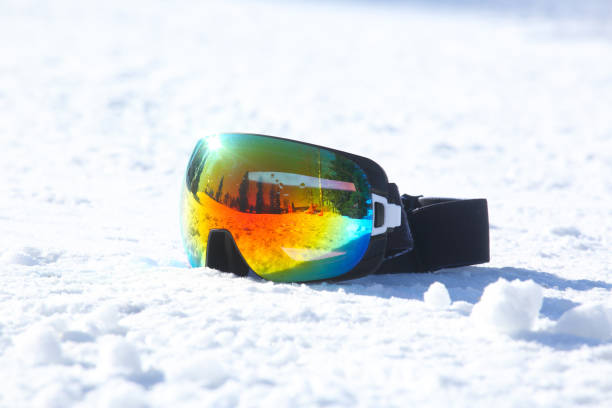 Ski and snowboard mask in snow Ski and snowboard mask in the snow background with copy space ski goggles stock pictures, royalty-free photos & images