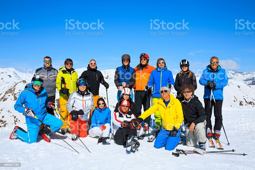 Ski club school skiing trips   Colorful group of snow skiers stock photo