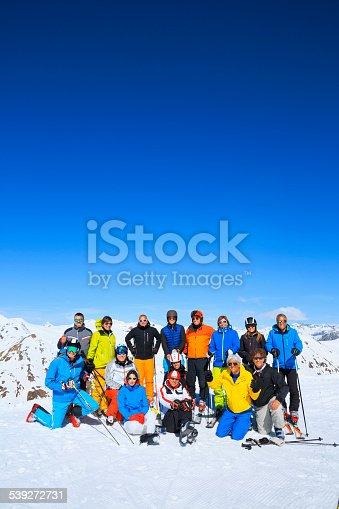 istock Ski club school skiing trips   Colorful group of snow skiers 539272731
