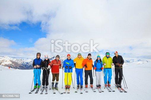 istock Ski club school skiing trips   Colorful group of snow skiers 620366760