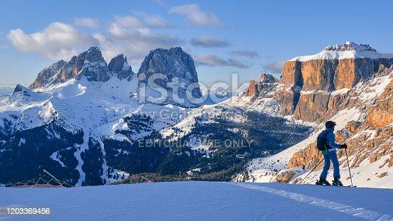 istock Ski domain Dolomiti Superski with panoramic views of Sassolungo and Sella group, at sunset. 1203369456
