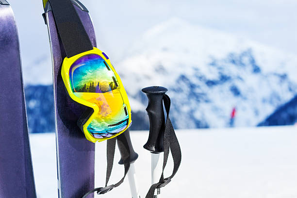 Ski equipment with skies mask and polles Mountain ski with reflective mask and poles with mountain peak and chairlift on background sochi stock pictures, royalty-free photos & images