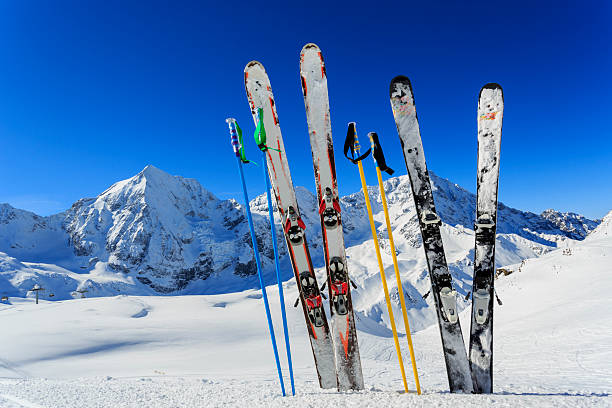 Ski equipments on snow Skiing, winter season , mountains and ski equipments in mountains ski resort stock pictures, royalty-free photos & images