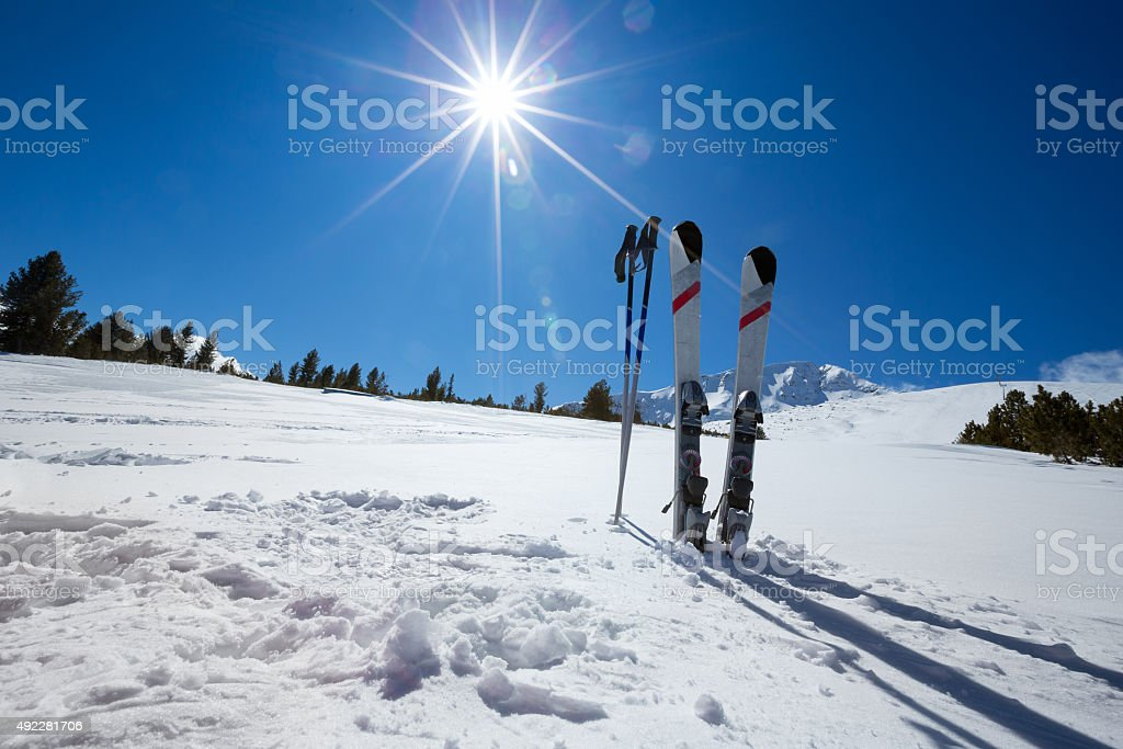ski equipments on sunny day stock photo