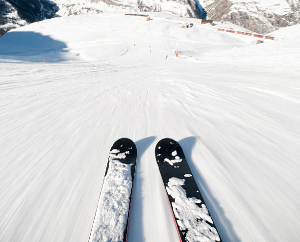 Ski Exhiliration Skiing down a steep piste at high speed. steep stock pictures, royalty-free photos & images