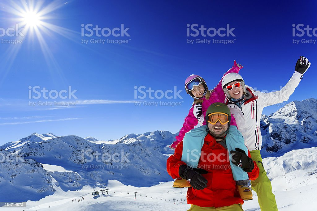 Ski family enjoying winter stock photo