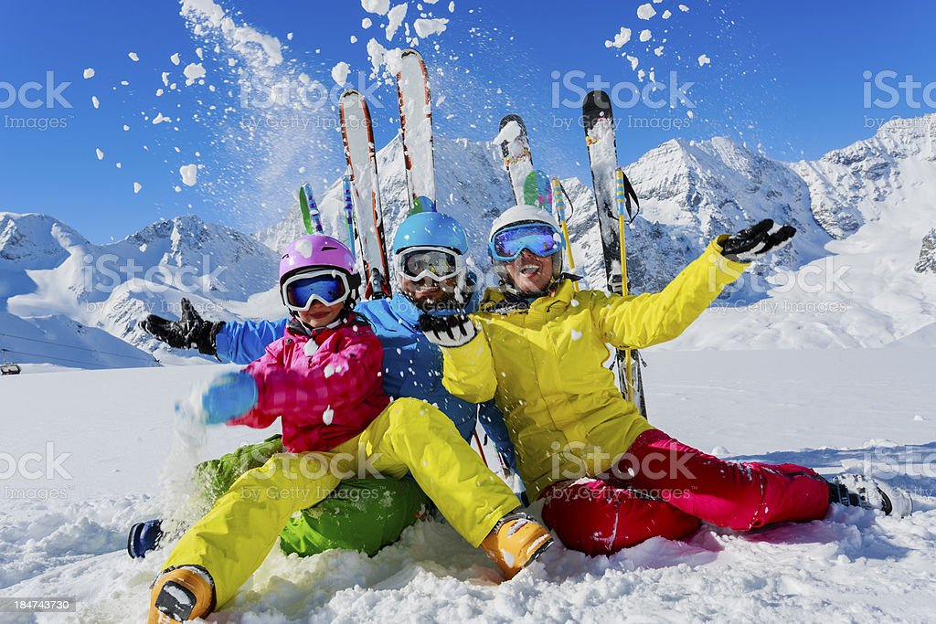 Ski family enjoying winter stock photo