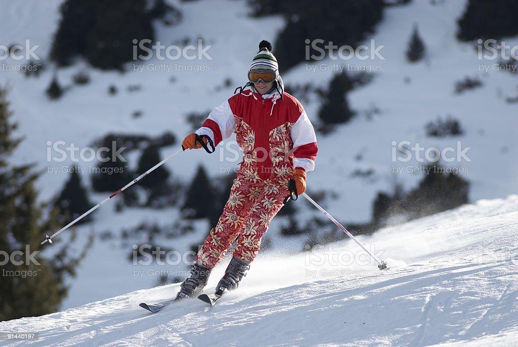 Ski girl turn on slope stock photo