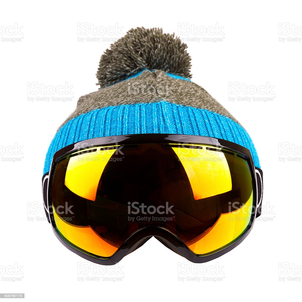 ski goggles and woolen hat isolated on white stock photo
